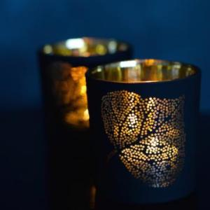 Black and gold tea light holder, £6